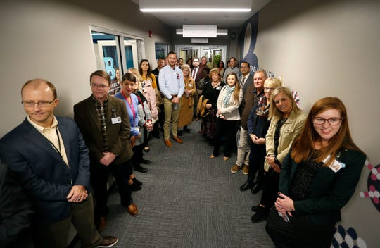 Burrell Behavioral Health employees listen to a speech by Burrell President and CEO C.J. Davis during an open house for the center's new Youth Focus Clinic on Friday, Nov. 8, 2019.
