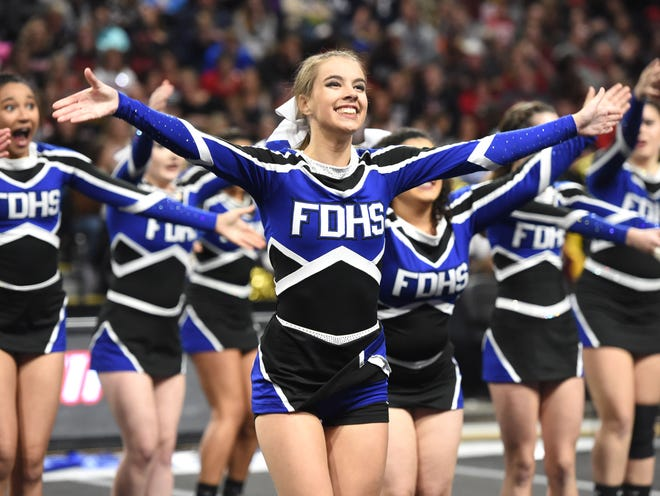 Taylor Mitchell cheers with her Fort Defiance teammates in the 2019 state championship at VCU.