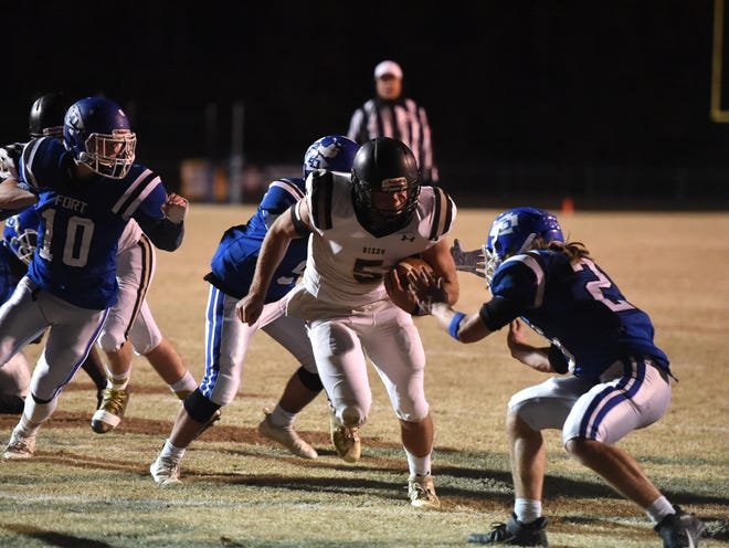 Buffalo Gap's Seth Fitzgerald breaks through the Fort Defiance defense for a touchdown this past season.
