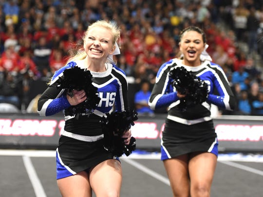 The Fort Defiance competition cheer team performs in the first round of the Class 3 state meet Saturday, November 9, at VCU.