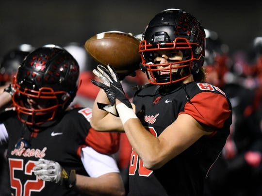 ROCORI receiver Andrew Anderson throws the ball on the sideline before their game against Delano in the Class 4A state quarterfinals Friday, Nov. 8, 2019, at Husky Stadium.