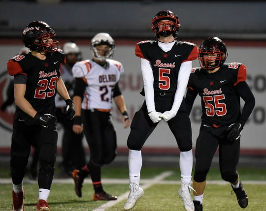ROCORI junior Drew Schneider celebrates a turnover on downs against Delano in the Class 4A state quarterfinals Friday, Nov. 8, 2019, at Husky Stadium.