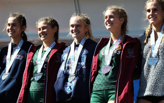 Chiles seniors Caitlin Wilkey (right) and Alyson Churchill finished 3rd and 5th respectively in the Class 3A girls race in the FHSAA Cross Country State Championships at Tallahassee's Apalachee Regional Park on Nov. 9, 2019.