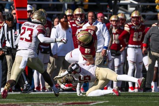 Nov 9, 2019; Chestnut Hill, MA, USA;  Florida State Seminoles linebacker Emmett Rice (56) tackles Boston College Eagles tight end Korab Idrizi (85) during the first half at Alumni Stadium. Mandatory Credit: Paul Rutherford-USA TODAY Sports