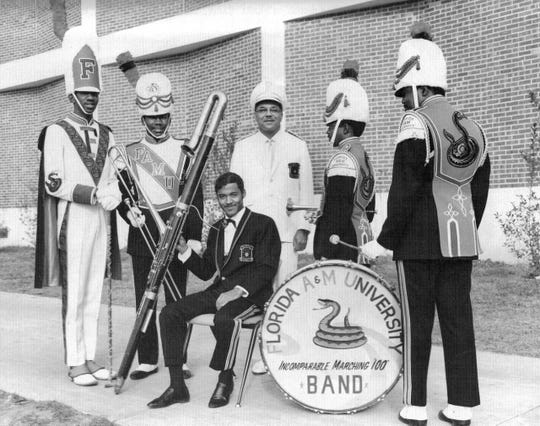 The late William P. Foster, center, with members of the Marching 100 in this file photo.