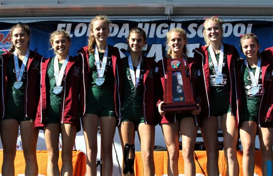Chiles' girls cross country team celebrates a Class 3A state runner-up at the FHSAA Cross Country State Championships at Tallahassee's Apalachee Regional Park on Nov. 9, 2019. From left: Megan Churchill, Alyson Churchill, Kelly Davis, Ella Hodges, Caitlin Wilkey, Emily Molen, Ashley Murphy.