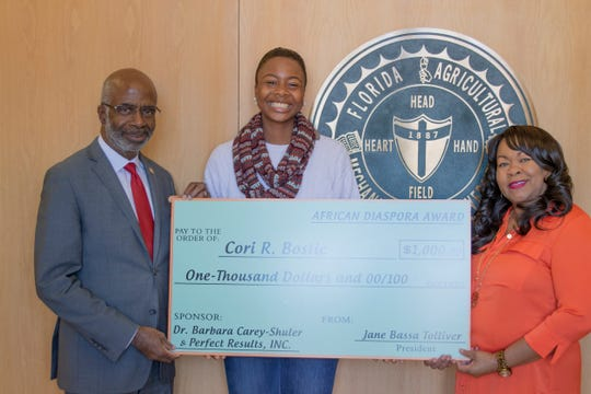 FAMU senior broadcast journalism major and first female drum major of Marching 100 receives check for $1,000 from Perfect Results, Inc..