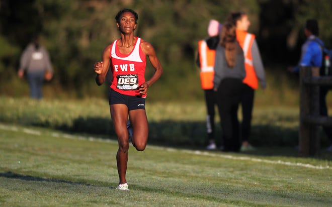 Fort Walton Beach's Kambry Smith races to the finish of the Class 3A girls race of the FHSAA Cross Country State Championships at Tallahassee's Apalachee Regional Park on Nov. 9, 2019.
