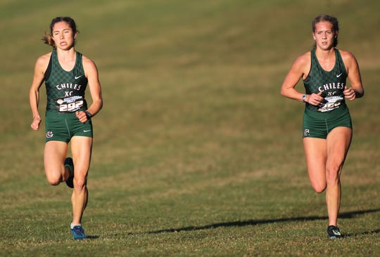 Chiles seniors Alyson Churchill and Caitlin Wilkey sitting in third and fourth place halfway through the Class 4A girls race in the FHSAA Cross Country State Championships at Tallahassee's Apalachee Regional Park on Nov. 9, 2019.