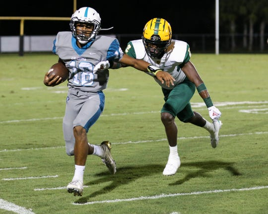 Jensen Beach's DaQuan Gonzales moves the ball up the field against Miami Killian in a Region 4-5A quarterfinal at Jensen Beach High School on Friday, Nov. 8, 2019.