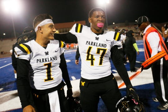 Parkland's Gabriel Herrera (1) and Malik Mccoy (47) walk off the field together after their win against Canutillo in the District 1-5A, Division II championship Friday, Nov. 8, at Canutillo High School in El Paso.