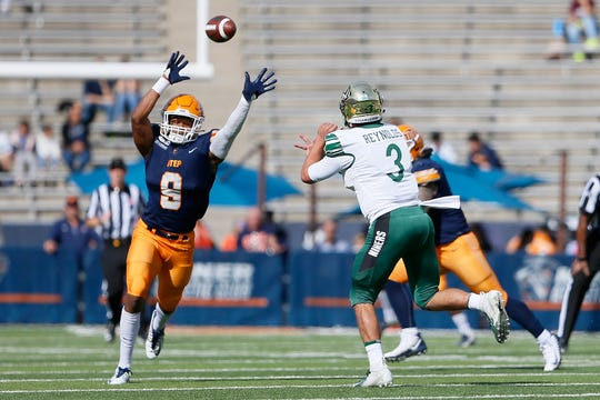UTEP's Alan Busey attempts to block a pass against Charlotte's Chris Reynolds during the game Saturday, Nov. 9, at the Sun Bowl in El Paso.