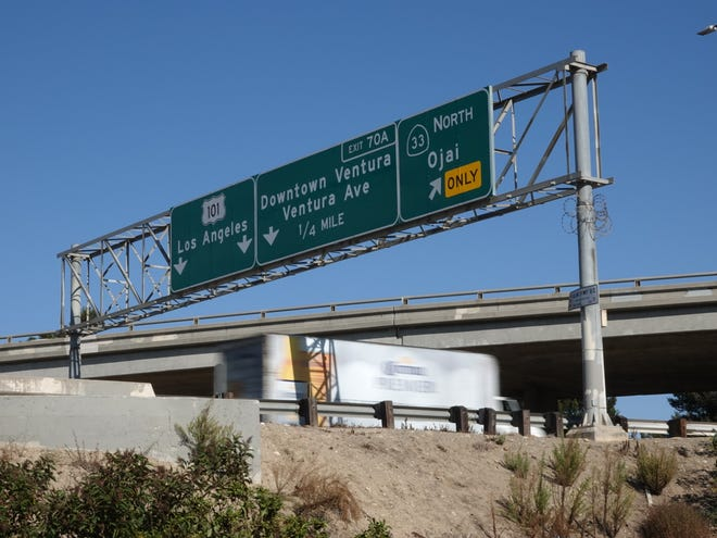 STAR FILE PHOTO Signage on southbound Highway 101 near the transition with Highway 33.