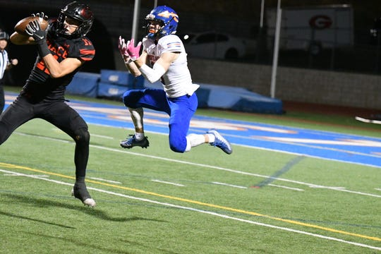 Grace Brethren's Nate Bennett intercepts a pass intended for Westlake's Carson Kuhl during a Division 3 first-round game Friday night at Westlake High. Grace Brethren won, 42-38.