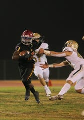 Oxnard High's Xavier Harris breaks free from St. Bonaventure High's Kian Betancourt during the second quarter of their CIF-SS Division 5 first-round game on Friday night. Harris scored four touchdowns in Oxnard's 40-13 win.