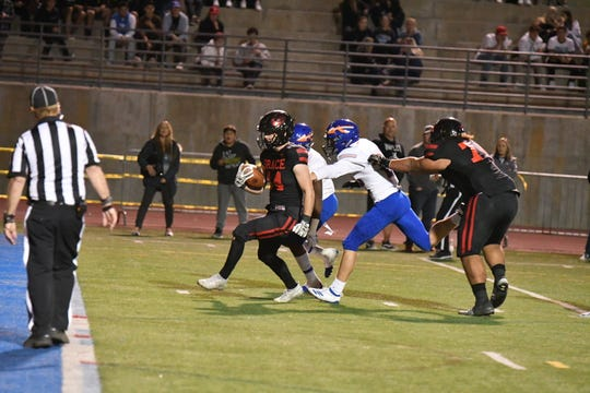 Grace Brethren's Josh Henderson scores one of his five touchdowns during the Lancers' 42-38 win over host Westlake in a Division 3 first-round game Friday night.