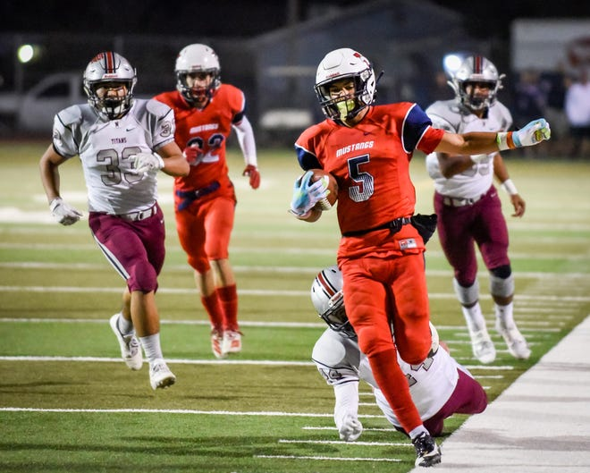 Tulare Western's Mikey Ficher runs back a punt return against Nipomo in a Central Section Division II high school playoff football game at Bob Mathias Stadium on Friday, Nov. 8, 2019.