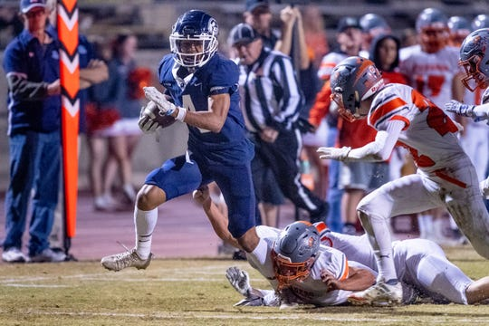 Redwood's Diamond Davis runs against Atascadero in a Central Section Division II high school football game on Friday, November 8, 2019.