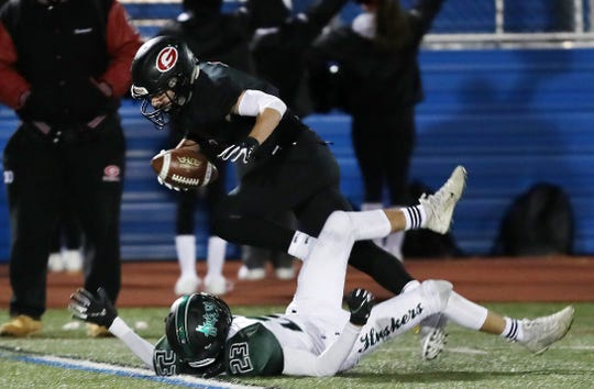 Rye's Matthew Tepedino (1) comes down with a pass in front of Yorktown's Nick Mehta (23)  during the Section 1 championship at Mahopac High School Nov. 8, 2019.