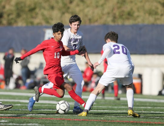 Hamilton's Brandon Ayala (10) works the ball as Rhinebeck's Ben Fajardo (20)  defends during the NYSPHSAA regional class C boys regional soccer finals at Pace University in Pleasantville on Saturday, November 9, 2019.