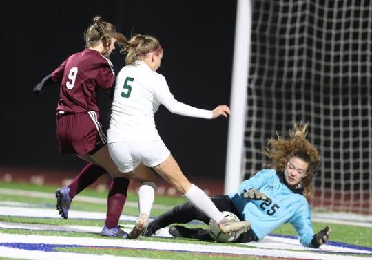 Pleasantville's Allison Portera (5) fights to get the ball past O'Neill Kara Hartley (25)  goalie during their 4-0 win in class B girls soccer state quarterfinal match at Goshen High School on Friday, November 8, 2019.