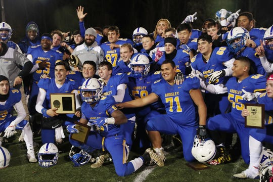Ardsley players celebrate their victory over Byram Hills to win the Section 1 Class B championship at Mahopac High School Nov. 9, 2019.