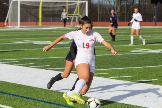 North Rockland's Madison Rodriguez shields the ball away from a Monroe-Woodbury player during the Class AA regional final game on Saturday, Nov. 9, 2019 at Goshen High School.