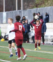 Mark DeAngelis (5) and Ossining defeated Monroe-Woodbury 1-0 in a NYSPHSAA class AA boys soccer regional finals at Pace University in Pleasantville on Saturday, November 9, 2019.