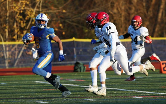 Ardsley's Jalen Osbourne (6) looks back at Byram Hills defenders as he runs for a first half touchdown during the Section 1 Class B championship at Mahopac High School Nov. 9, 2019.