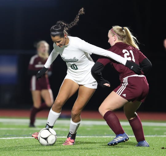 Pleasantville's Isabelle Kapoor (20) works the ball around O'Neill's Kate Barnes (21) during their 4-0 win in class B girls soccer state quarterfinal match at Goshen High School on Friday, November 8, 2019.