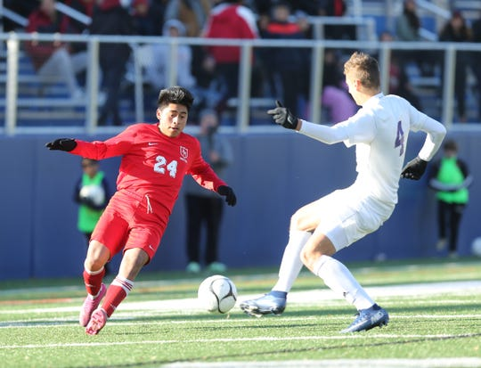Hamilton's Christopher Macas (24)  works against Rhinebeck's Declan Kroll (4) during the NYSPHSAA regional class C boys soccer finals at Pace University on Saturday, November 9, 2019.