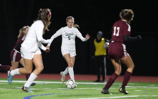 Pleasantville's Allison Portera (5) looks for a pass up field during their 4-0 win over O'Neill in  class B girls soccer state quarterfinal match at Goshen High School on Friday, November 8, 2019.