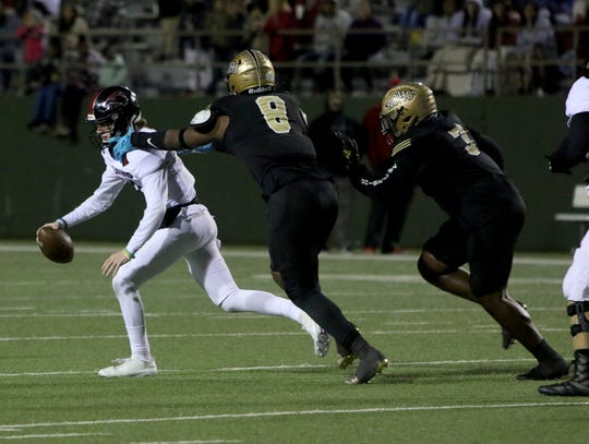 Rider's E'Maurion Banks sacks Wichita Falls High Zy Gravitt Friday, Nov. 8, 2019, at Memorial Stadium. The Raiders defeated the Coyotes 42-14.
