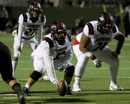 Wichita Falls High's Juan Prieto (52) and Robert Blue (74) line up against Rider Friday, Nov. 8, 2019, at Memorial Stadium. The Raiders defeated the Coyotes 42-14.
