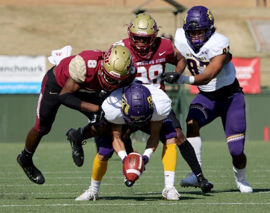Midwestern State's Jaydon Cunigan tackles Western New Mexico's Jevin Huddleston Saturday, Nov. 9, 2019, at Memorial Stadium. MSU Texas defeated WNMU 28-13.