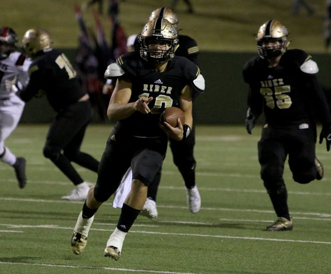Rider's Jacob Rodriguez runs for a first down against Wichita Falls High Friday, Nov. 8, 2019, at Memorial Stadium. The Raiders defeated the Coyotes 42-14.