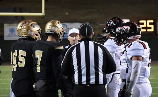 Captains from Rider and Wichita Falls High School meet at midfield for the coin toss Nov. 8, 2019 at Memorial Stadium. The in-town rivals will meet again Friday in the state playoffs.