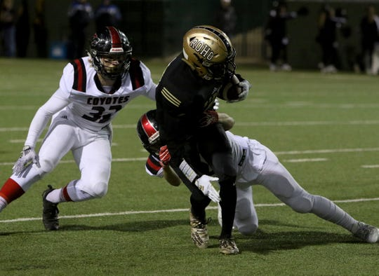 Rider's Nick Darcus is tackled by Wichita Falls High's Noah Williams Friday, Nov. 8, 2019, at Memorial Stadium. The Raiders defeated the Coyotes 42-14.