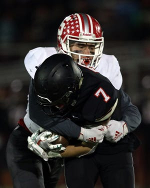 Sheridan linebacker Shay Taylor, pictured here tackling Jonathan Alder quarterback Jacob Fenik during the 2019 playoffs, leads a veteran Generals squad again with high hopes. Taylor is among 20 seniors and 23 lettermen returning for the 2020 season.