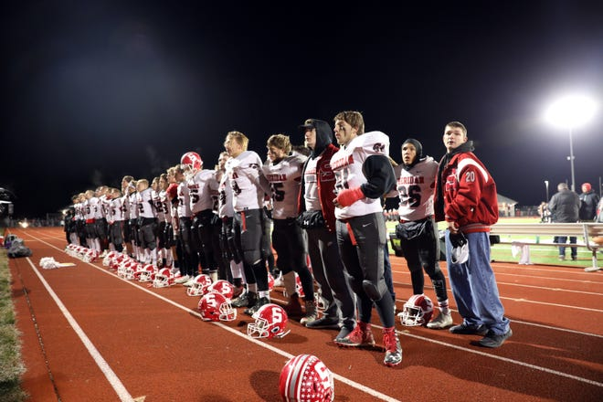 Sheridan players sing to their fans after falling in the 2019 football playoffs to Jonathan Alder.