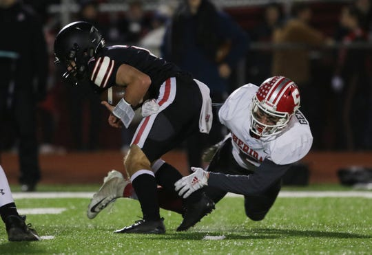 Sheridan's Shay Taylor sacks Jonathan Alder's JT Keith. Taylor was one of four Generals to receive All-Ohio accolades.