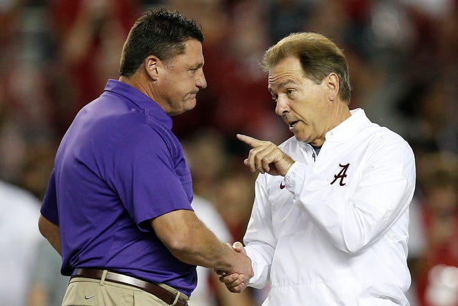 LSU coach Ed Orgeron, left, and Alabama coach Nick Saban shake hands prior to their teams' game in 2017.