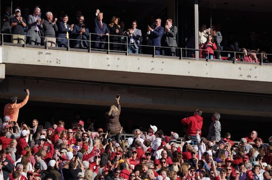 President Donald Trump and Melania Trump wave to fans in the first quarter at Bryant-Denny Stadium. Mandatory Credit: John David Mercer-USA TODAY Sports