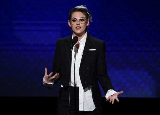 Kristen Stewart toasted Charlize Theron Friday night.