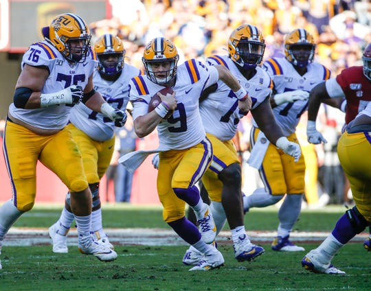 LSU quarterback Joe Burrow carries the ball against Alabama during the first half at Bryant-Denny Stadium.