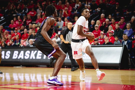 Montez Mathis of the Rutgers Scarlet Knights drives against Niagara.