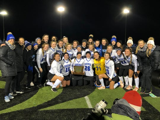 The Shore Regional field hockey team celebrates winning the NJSIAA Group 1 State Title on Nov. 9, 2019 at Bordentown Regional High School.