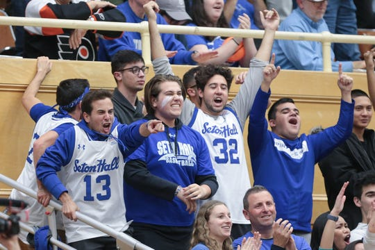 Seton Hall Pirate fans cheer during the second half of a game between the Seton Hall Pirates and the Stony Brook Seawolves at Walsh Gymnasium.