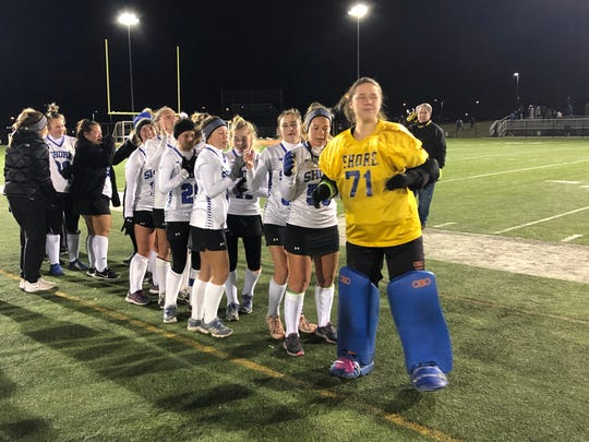 The Shore Regional field hockey team lines up to shake hands with Haddonfield after winning the NJSIAA Group 1 State Title on Nov. 9, 2019 at Bordentown Regional High School.
