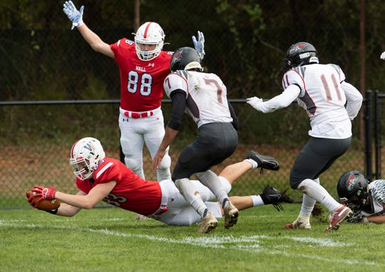 Wall Blake Rezk dives in for one of Wall's many first half touchdowns. Wall High School football easily handles Allentown in first round NJSIAA playoffs in Wall NJ on November 10, 2019